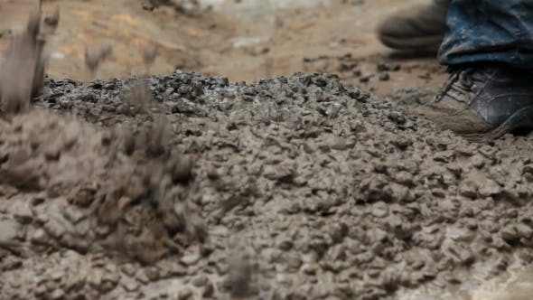 Thumbnail for Construction Workers Mixing Concrete