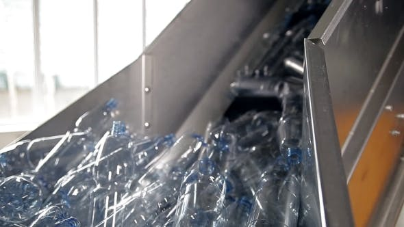 Cover Image for Empty Plastic Bottles For Water Are Moving On The Conveyor