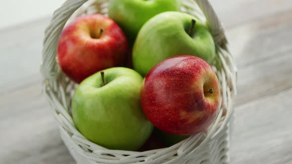 Mixed Green and Red Apples in Basket