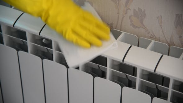 Thumbnail for Female Hand In  Rubber Glove Cleans Heating Radiator