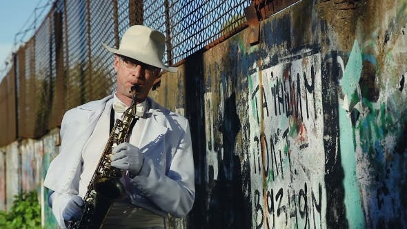Thumbnail for Saxophonist Against a Wall With Graffiti And Power Lines. Series.