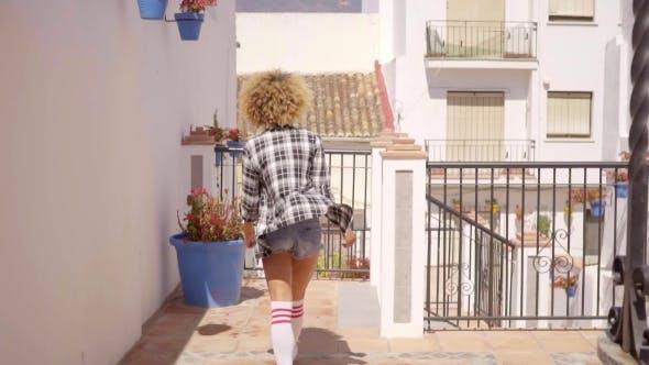 Thumbnail for Woman Walks The Mediterranean Backyard Along