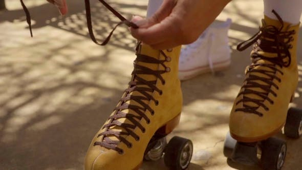 Thumbnail for Female Hands Tie Up Roller Laces