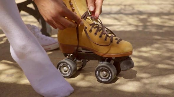 Thumbnail for Young Woman Putting On Roller Skates