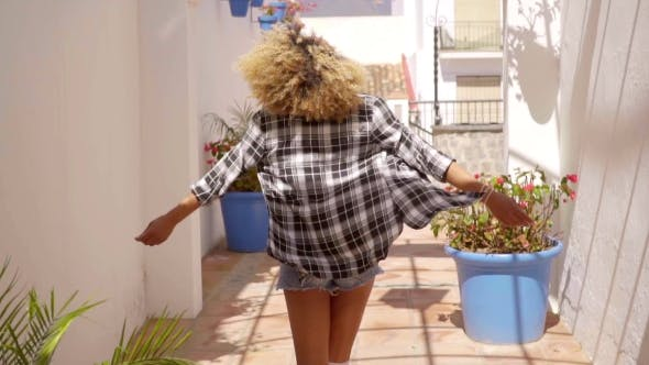 Cover Image for Model Walks The Mediterranean Backyard Along