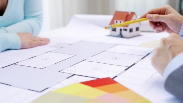 Cover Image for Woman And Architect Discussing Blueprint Of House 25