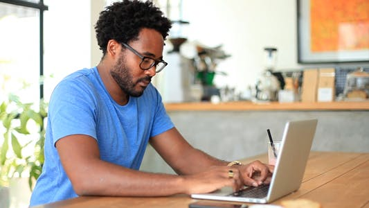 Freelancer Working In Coffee Shop
