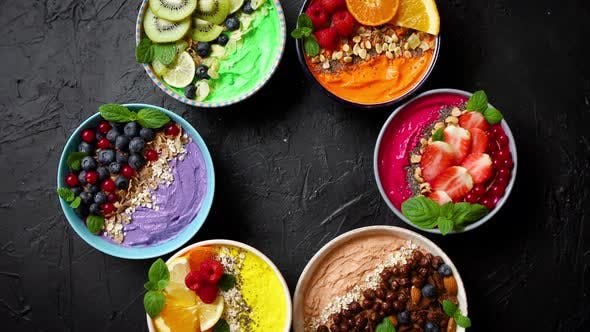 Thumbnail for Various Healthy Fresh Smoothies or Yogurts in Bowls, With Strawberries, Kiwi, Chia, Blackberries