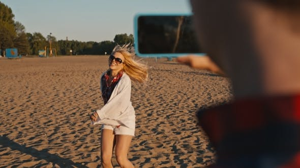 Thumbnail for Beautiful Girl Dancing On The Beach Her Boyfriend Shooting This On Phone