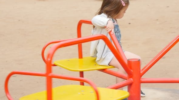 Thumbnail for Happy Toddler Girl On The Playground