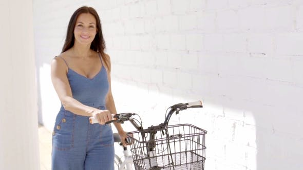 Thumbnail for Attractive Happy Woman With Her Bicycle