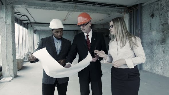 Thumbnail for Men, Woman In Suit And Helmet Discuss Blueprint, Communicate With Buyer. Chief Engineer Builder