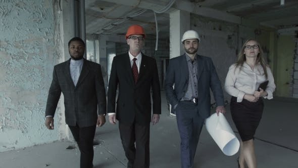 Thumbnail for Team Of Builders In Suits, Hard Hat, Move, Look Directly Into Camera. Black Man, Aged Engineer