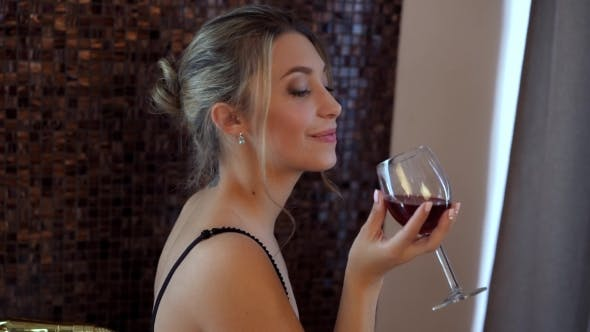 Thumbnail for Beautiful Girl With a Glass Of Wine In Bathroom