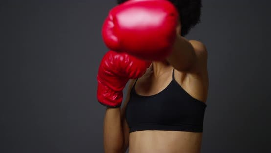 Thumbnail for Strong Black Woman Athlete with boxing gloves on dark background