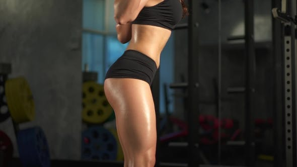Thumbnail for Beautiful Sporty Hot Woman Doing Squat Workout In Gym