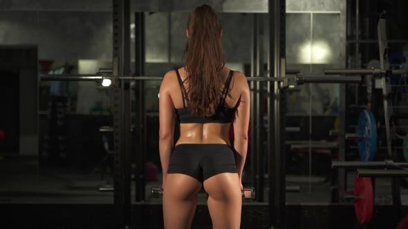 Thumbnail for Fitness Girl With Dumbbells From Behind