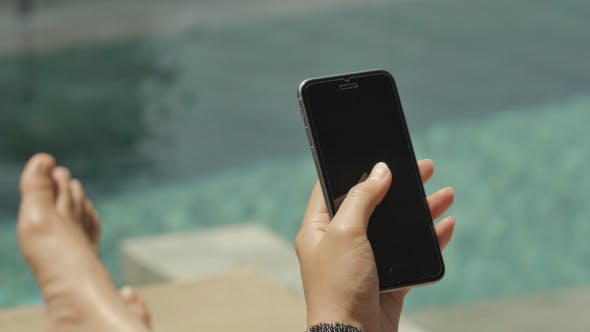 Play Smartphone At Poolside