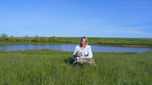Pretty Girl Plays With a Dog On The Grass By The Lake Nature Animals Pets Friend Emotions Happy