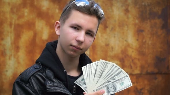 Thumbnail for Footage Teenager Showing Off Their Money.