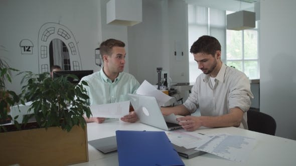 Thumbnail for Business Partners Working In a Light And Modern Open Plan Office Space.