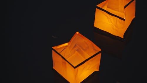 Glowing Paper Lantern Floats On Water