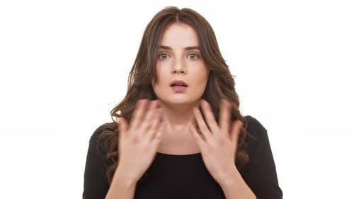 Attractive Brunette Caucasian Female Crying Out in Surprise Standing on White Background