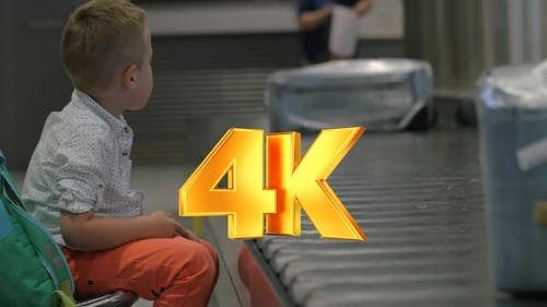 Child Waiting At The Baggage Claim Area