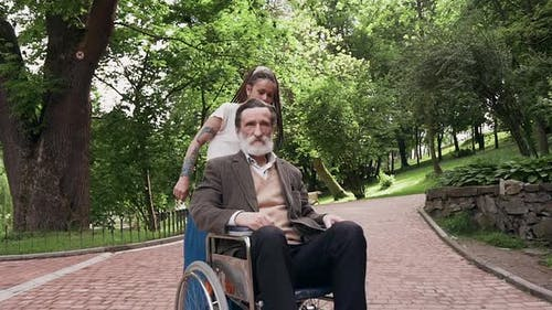 Girl which Having Fun Together with Her Respected Satisfied Bearded Granddad