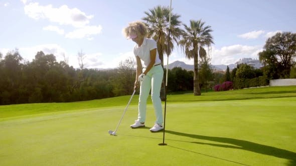 Thumbnail for Attractive Young Woman Playing a Golf Shot