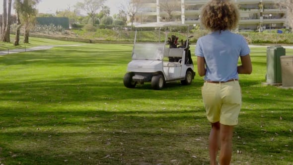 Thumbnail for Woman Golfer Walking Back To The Golf Cart