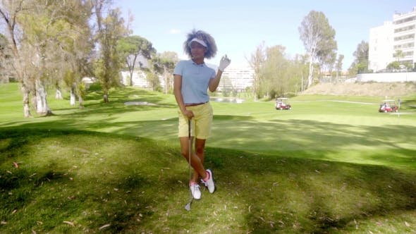 Thumbnail for Attractive Young Woman Golfer Standing Watching