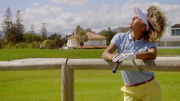 Thumbnail for Attractive Female Golfer Leaning On a Wooden Fence