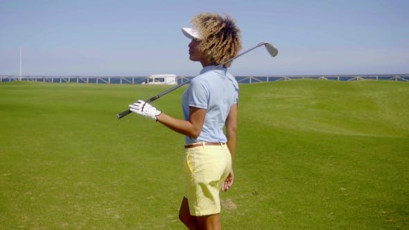 Thumbnail for Attractive Young Female Golfer Watching The Ball
