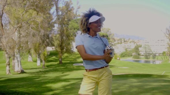 Thumbnail for Smiling Young Woman Golfer On a Golf Course
