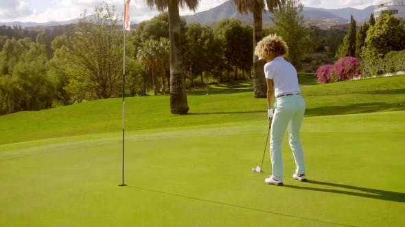 Thumbnail for Young Female Golfer Playing a Putting Shot