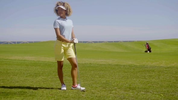 Cover Image for Young Woman Golfer Standing Watching