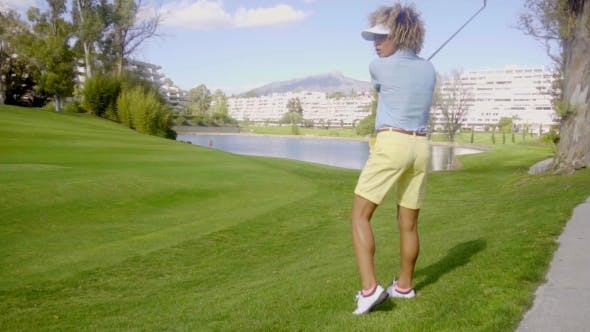 Thumbnail for Young Woman Lining Up Her Golf Shot