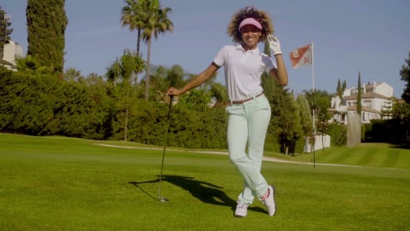 Thumbnail for Pretty Young Woman Golfer Posing With The Ball