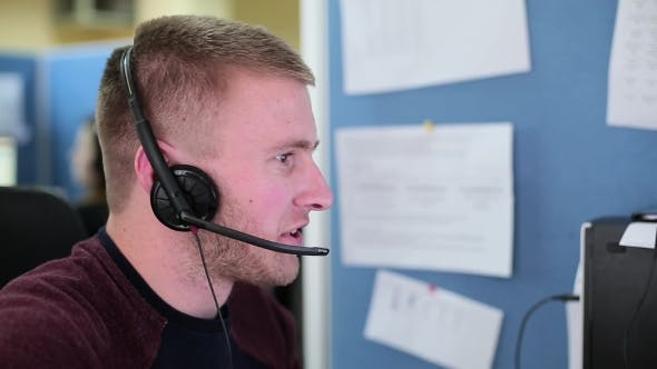 Thumbnail for Man Talking With a Client In a Call Center