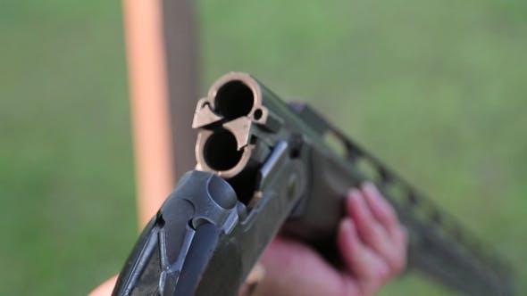 Man Inserts Bullets In The Gun
