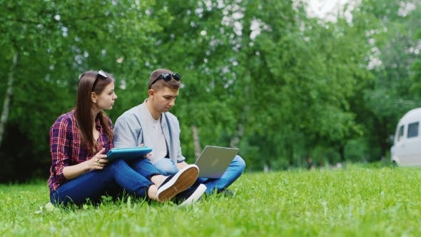 Thumbnail for College Students Studying Together In Nature. Enjoy Your Tablet And Laptop