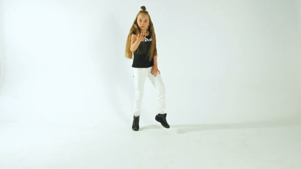Cover Image for Young People Teenage Concept - Stylish Young Model Teenage Girl In Casual Style Clothes Dancing
