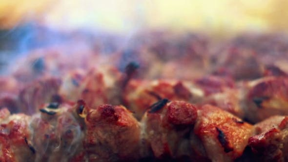 Grilled Meat With Smoke. Arabic Food. Cooked Meat With Crust