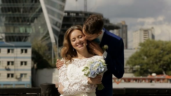 Thumbnail for Romantic Wedding Couple Kissing In The City