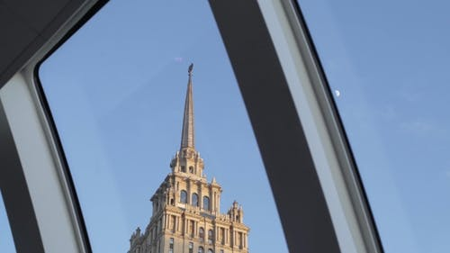 Spire Of The Building Through The Porthole