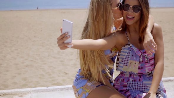 Thumbnail for Laughing Young Woman Taking a Selfie