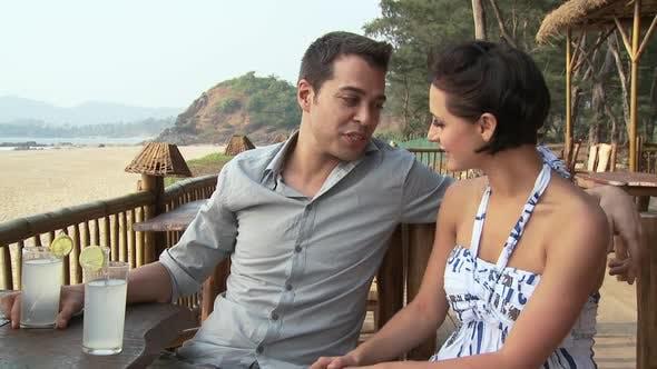 Thumbnail for Couple at beach bar