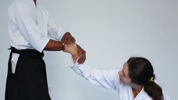 Thumbnail for Martial Arts Master In Black Hakama Practice Aikido With a Woman