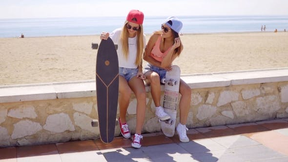 Thumbnail for Two Pretty Friends Hold Skateboards On Wall